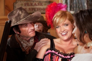 bigstock-Dusty-Cowboy-And-Saloon-Girls